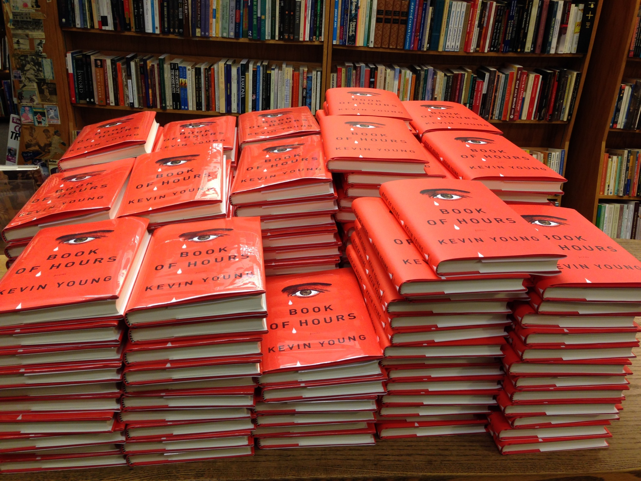 Photo of stacks of Kevin Young's 'Book of Hours'