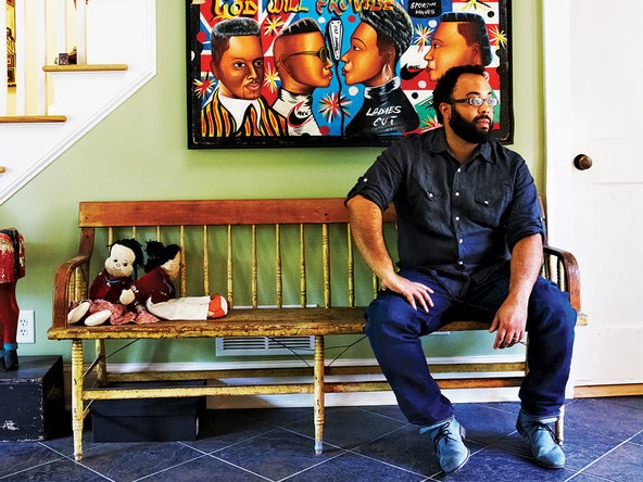 Photo of Kevin Young seated on a bench.